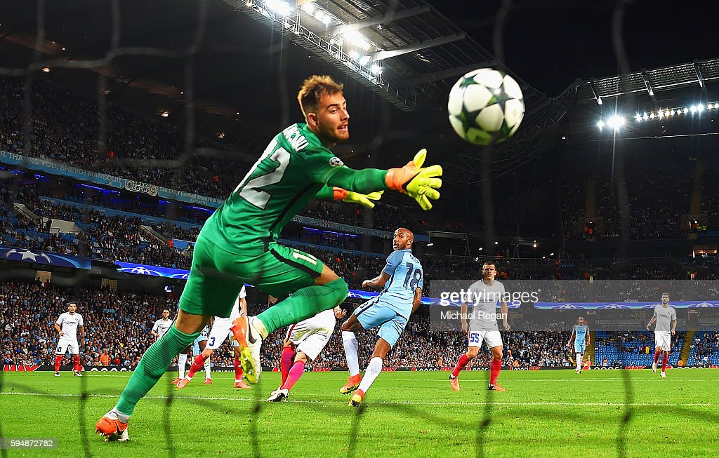 Fabian Delph of Manchester City scores the opening goal past Valentin Cojocaru of Steaua Bucharest during the UEFA Champions League Play-off Second Leg match between Manchester City and Steaua Bucharest at Etihad Stadium on August 24, 2016 in Manchester, England.