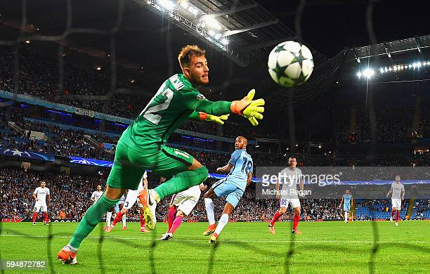 Fabian Delph of Manchester City scores the opening goal past Valentin Cojocaru of Steaua Bucharest during the UEFA Champions League Playoff Second...