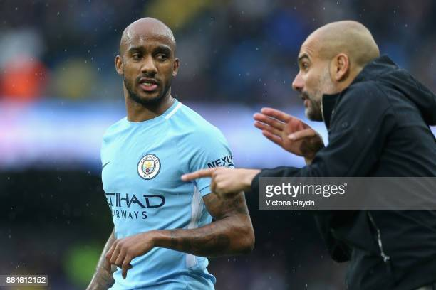 Fabian Delph of Manchester City speaks with Josep Guardiola during the Premier League match between Manchester City and Burnley at Etihad Stadium on...