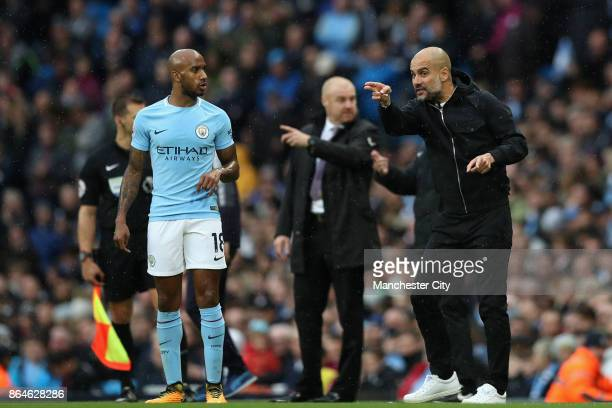 Fabian Delph speaks with Josep Guardiola Manager of Manchester City during the Premier League match between Manchester City and Burnley at Etihad...