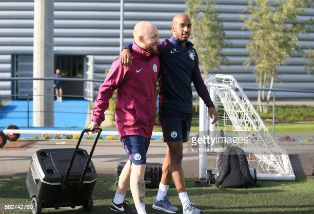 Fabian Delph Walks out with kitman Brandon Ashton on the way to training at Manchester City Football Academy on October 18 2017 in Manchester England