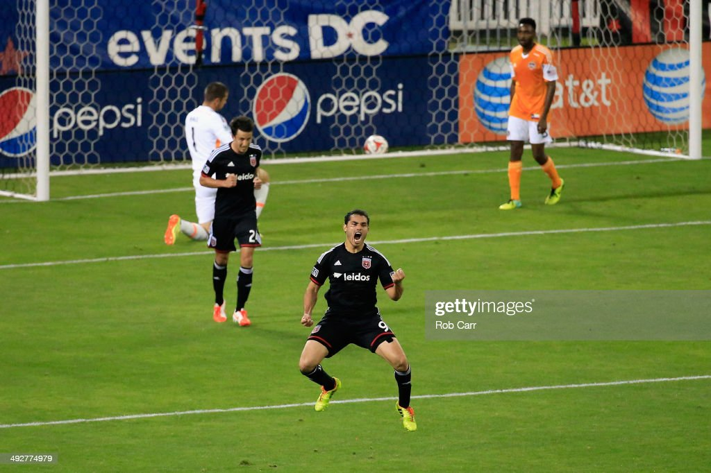 Fabian Espindola of DC United celebrates after scoring a goal against the Houston Dynamo during the second half at RFK Stadium on May 21 2014 in...