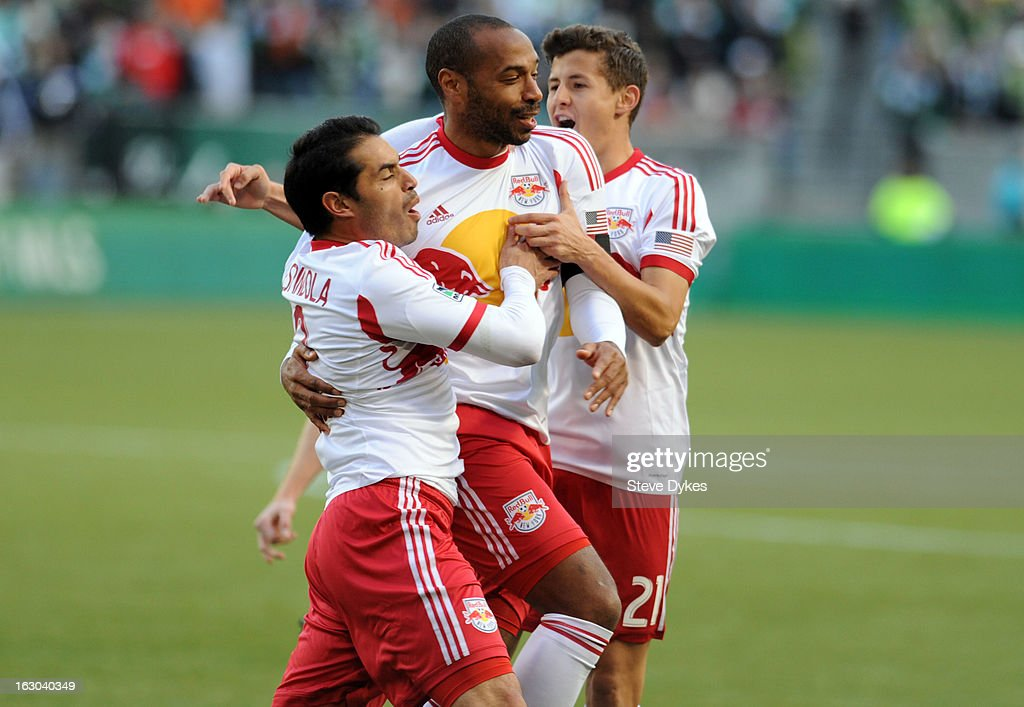 <a gi-track='captionPersonalityLinkClicked' href=/galleries/search?phrase=Fabian+Espindola&family=editorial&specificpeople=4476356 ng-click='$event.stopPropagation()'>Fabian Espindola</a> #9 of New York Red Bulls celebrates with <a gi-track='captionPersonalityLinkClicked' href=/galleries/search?phrase=Thierry+Henry&family=editorial&specificpeople=167275 ng-click='$event.stopPropagation()'>Thierry Henry</a> #14 of New York Red Bulls and Ruben Bover #21 of New York Red Bulls after scoring the first of his two first half goals during the first half of the game against the Portland Timbers at Jeld-Wen Field on March 03, 2013 in Portland, Oregon.