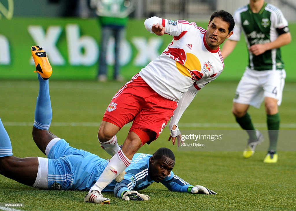 <a gi-track='captionPersonalityLinkClicked' href=/galleries/search?phrase=Fabian+Espindola&family=editorial&specificpeople=4476356 ng-click='$event.stopPropagation()'>Fabian Espindola</a> #9 of New York Red Bulls scores the first of his two first half goals as goal keeper Donovan Ricketts #1 of Portland Timbers sprawls on the turf during the first half of the game at Jeld-Wen Field on March 03, 2013 in Portland, Oregon.