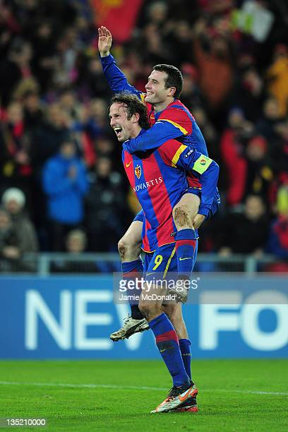 Fabian Frei and Marco Streller of Basel celebrate victory after the UEFA Champions League Group C match between FC Basel 1893 and Manchester United...