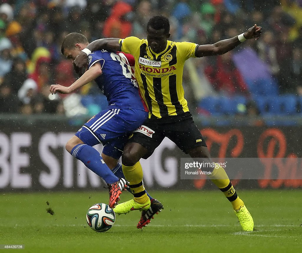 Fabian Frei (L) of Basel and Sekou Sanogo of Bern compete for the ball during the Raiffeisen Super League match between FC Basel and BSC Young Boys Bern at St.Jakob-Park on August 31, 2014 in Basel, Switzerland.