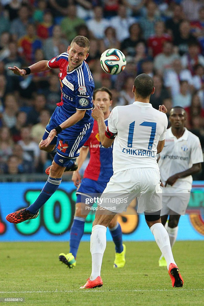 <a gi-track='captionPersonalityLinkClicked' href=/galleries/search?phrase=Fabian+Frei&family=editorial&specificpeople=4783637 ng-click='$event.stopPropagation()'>Fabian Frei</a> (L) of FC Basel fights for the ball with Yassine Chikhaoui of FC Zurich during the Raiffeisen Super League match between FC Basel and FC Zurich at St. Jakob-Park on August 9, 2014 in Basel, Switzerland.