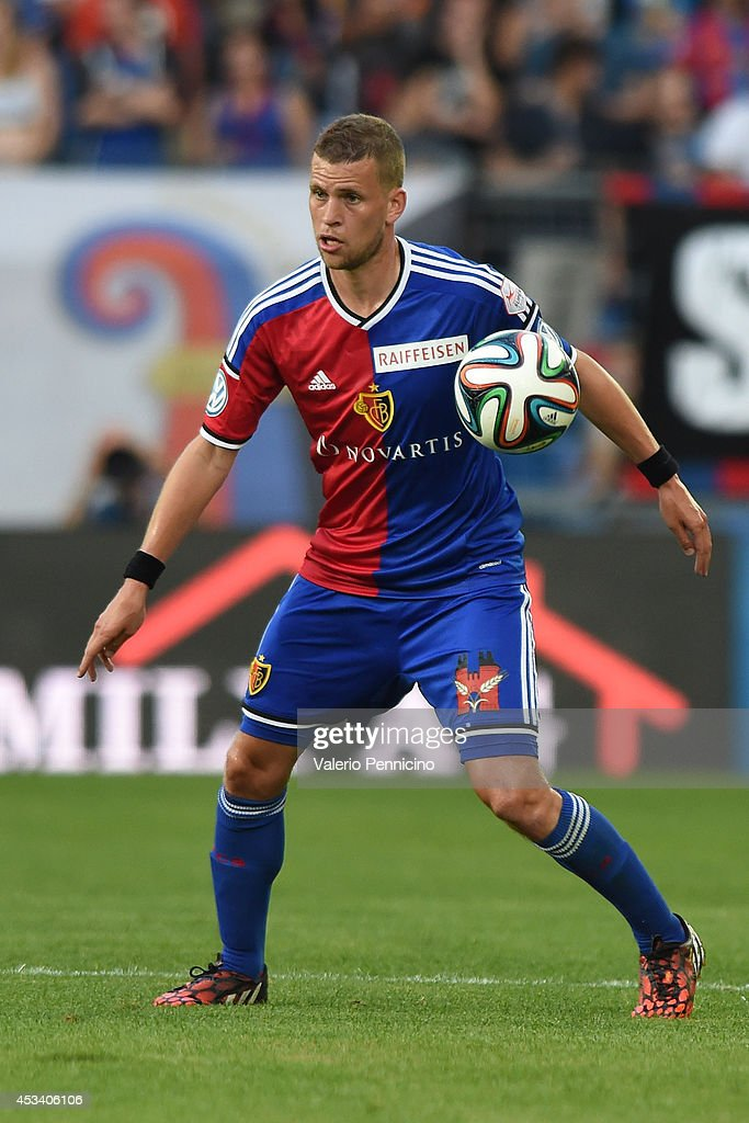 <a gi-track='captionPersonalityLinkClicked' href=/galleries/search?phrase=Fabian+Frei&family=editorial&specificpeople=4783637 ng-click='$event.stopPropagation()'>Fabian Frei</a> of FC Basel in action during the Raiffeisen Super League match between FC Basel and FC Zurich at St. Jakob-Park on August 9, 2014 in Basel, Switzerland.