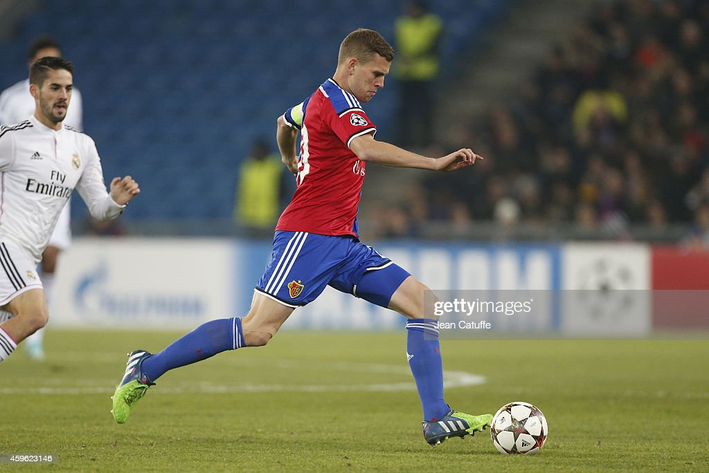 <a gi-track='captionPersonalityLinkClicked' href=/galleries/search?phrase=Fabian+Frei&family=editorial&specificpeople=4783637 ng-click='$event.stopPropagation()'>Fabian Frei</a> of FC Basel in action during the UEFA Champions League Group B match between FC Basel 1893 and Real Madrid CF at St. Jakob-Park stadium on November 26, 2014 in Basel, Basel-Stadt, Switzerland.