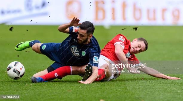 Fabian Frei of Mainz 05 challenges Yunus Malli of Wolfsburg during the Bundesliga match between 1 FSV Mainz 05 and VfL Wolfsburg at Opel Arena on...