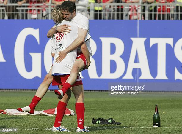 Fabian Gerber and Marco Rose of Mainz celebrate the staying in the first division the Bundesliga match between FSV Mainz 05 and Schalke 04 at the...