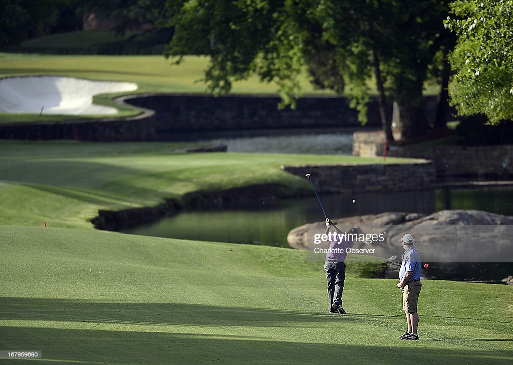 Fabian Gomez hits off the 7th fairway during the second round of the Wells Fargo Championship at Quail Hollow Club in Charlotte, North Carolina, on Friday, May 3, 2013.