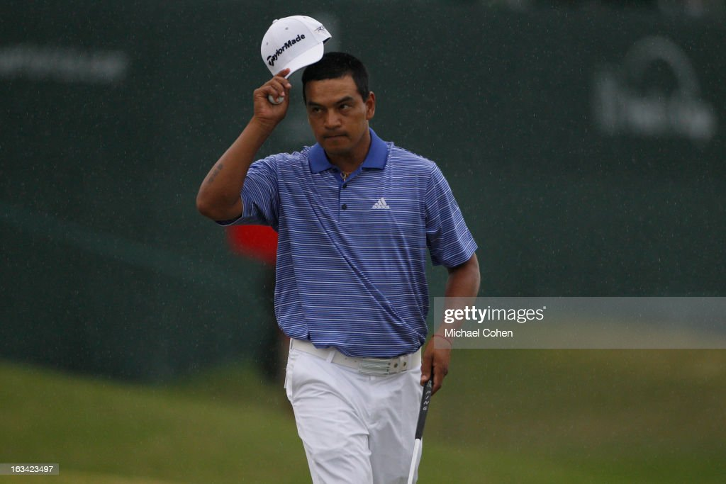 <a gi-track='captionPersonalityLinkClicked' href=/galleries/search?phrase=Fabian+Gomez&family=editorial&specificpeople=4605868 ng-click='$event.stopPropagation()'>Fabian Gomez</a> of Argentina acknowledges the gallery on the 18th green during the third round of the Puerto Rico Open presented by seepuertorico.com held at Trump International Golf Club on March 9, 2013 in Rio Grande, Puerto Rico.