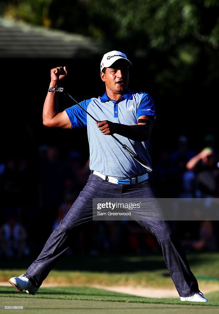 Fabian Gomez of Argentina celebrates after putting for birdie on the 18th green prior to a playoff against Brandt Snedeker during the final round of...