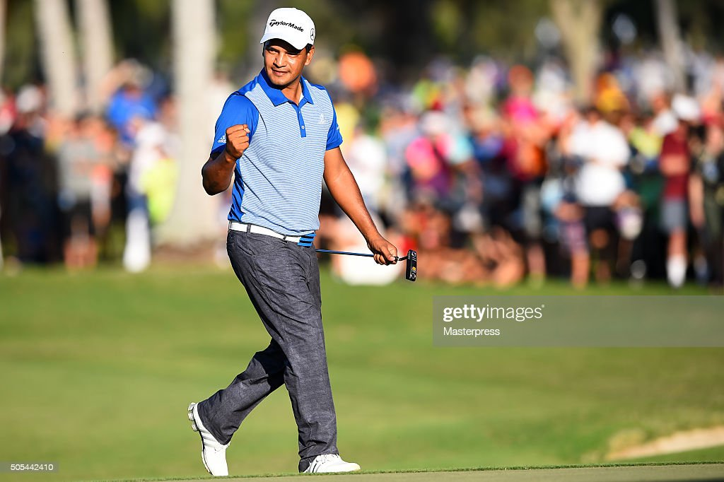 Fabian Gomez of Argentina celebrates after putting for birdie on the 18th green during the final round of the Sony Open In Hawaii at Waialae Country...