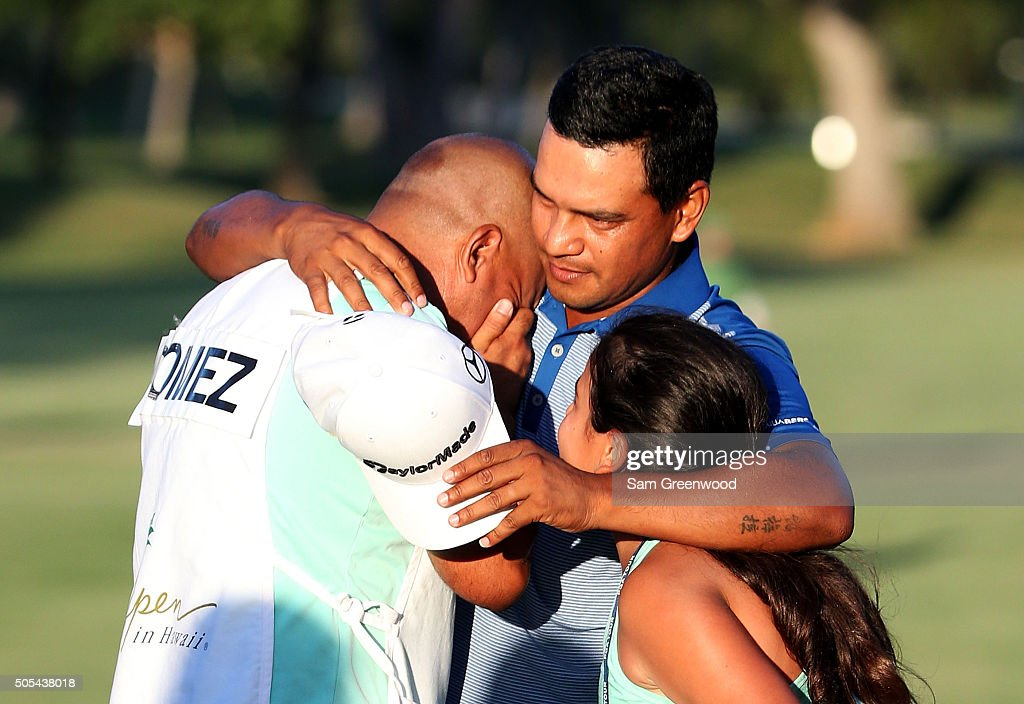 Fabian Gomez of Argentina celebrates with his caddie after winning during a playoff in the final round of the Sony Open In Hawaii at Waialae Country...