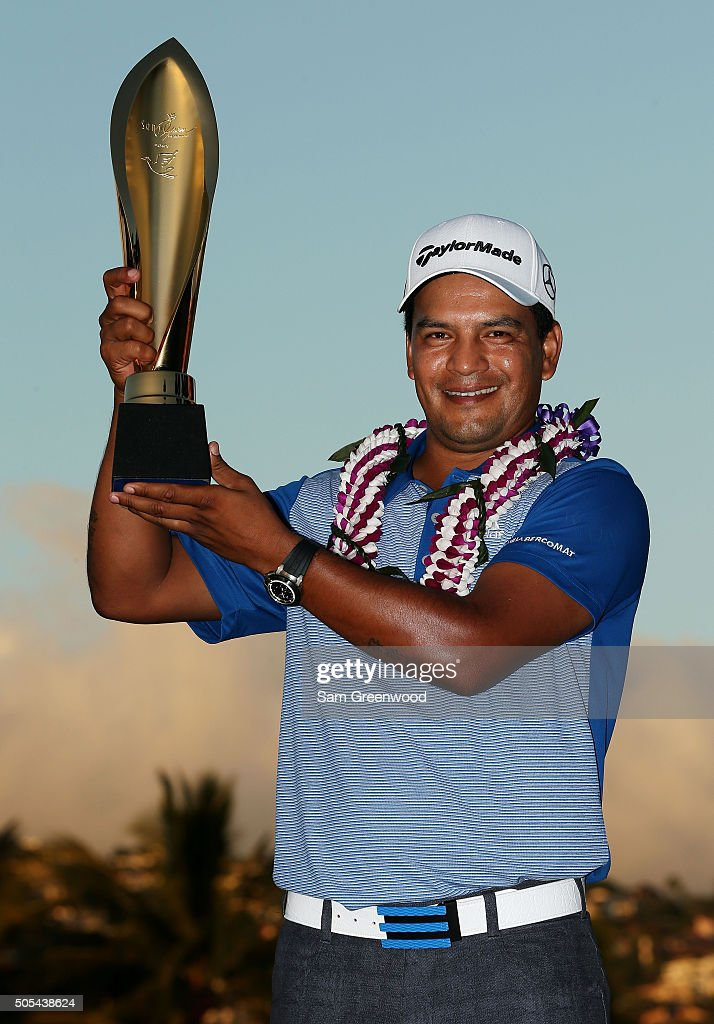 <a gi-track='captionPersonalityLinkClicked' href=/galleries/search?phrase=Fabian+Gomez&family=editorial&specificpeople=4605868 ng-click='$event.stopPropagation()'>Fabian Gomez</a> of Argentina celebrates with the winner's trophy after defeating Brandt Snedeker during a playoff during the final round of the Sony Open In Hawaii at Waialae Country Club on January 17, 2016 in Honolulu, Hawaii.