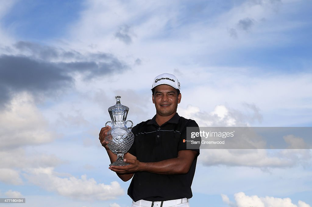 Fabian Gomez of Argentina poses with the winner's trophy after winning the final round of the FedEx St Jude Classic at TPC Southwind on June 14 2015...