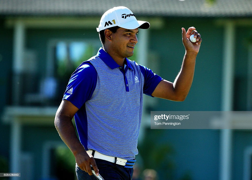 Fabian Gomez of Argentina reacts after putting for birdie on the 11th green during the final round of the Sony Open In Hawaii at Waialae Country Club...