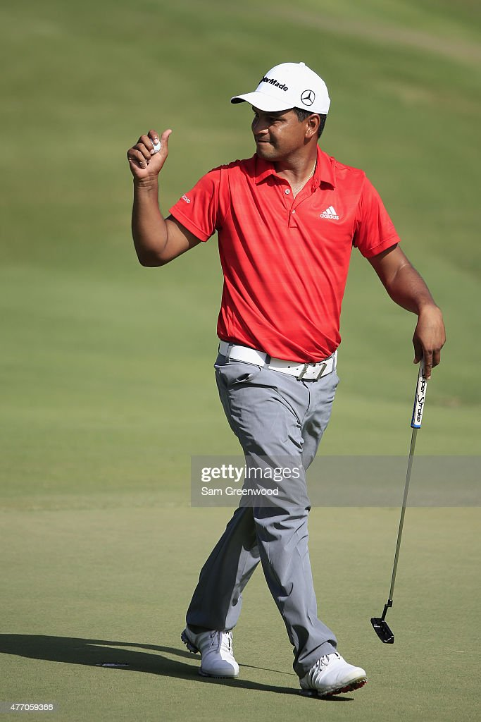 Fabian Gomez of Argentina reacts to a par putt on the 18th hole during round three of the FedEx St Jude Classic at TPC Southwind on June 13 2015 in...