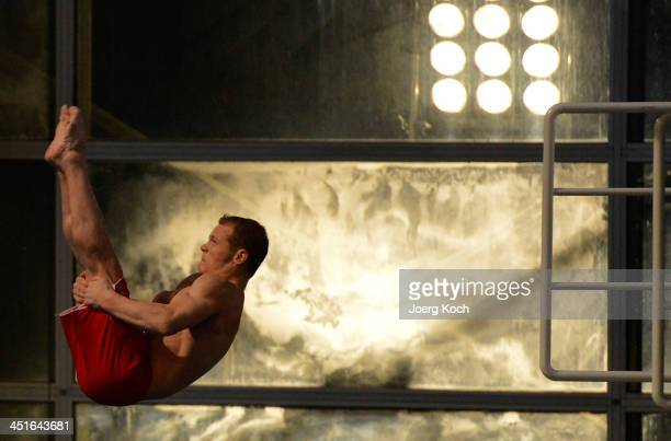 Fabian Hambuechen jumps during the TV show 'TV Total Turmspringen' on November 23 2013 in Munich Germany 'TV Total Turmspringen' is an annual TV show...