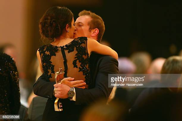 Fabian Hambuechen kisses Marcia Ev after he won the Sportler des Jahres 2016 award during the Sportler des Jahres 2016 gala at Kurhaus BadenBaden on...