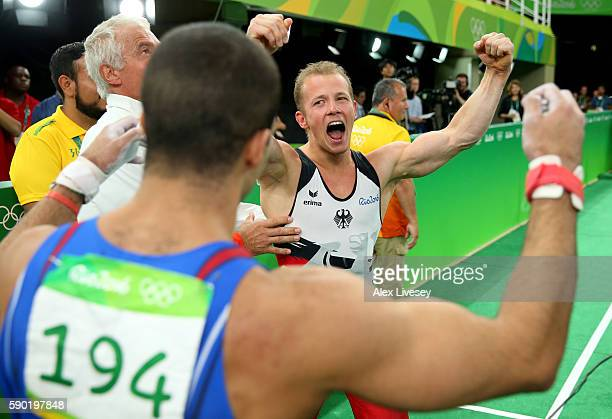 Fabian Hambuechen of Germany and Danell Leyva of the United States celebrate winning the gold and silver medal after competing on the Horizontal Bar...