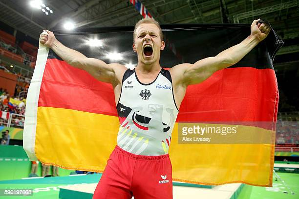 Fabian Hambuechen of Germany celebrates winning the gold medal after competing on the Horizontal Bar Final on Day 11 of the Rio 2016 Olympic Games at...