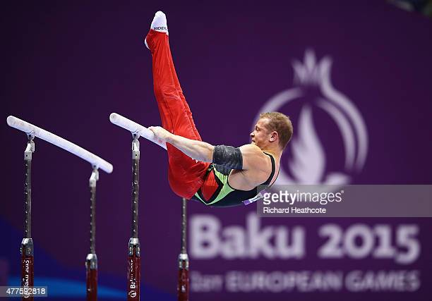 Fabian Hambuechen of Germany competes on the Parallel Bars in the Artistic Gymnastics Men's Individual All Round Final during day six of the Baku...