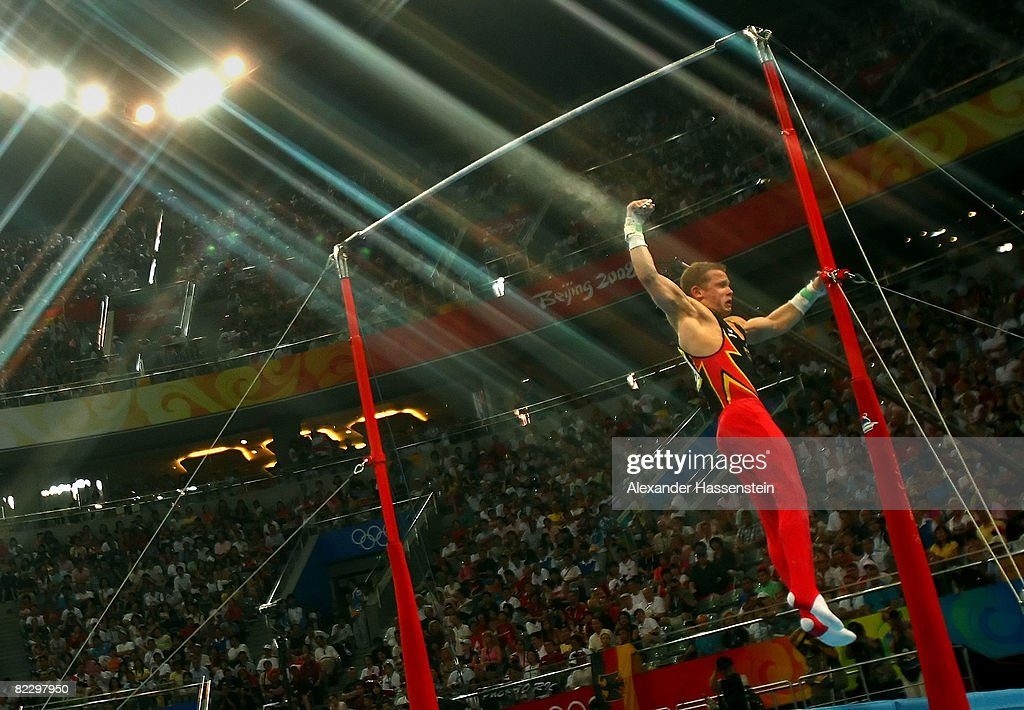 Fabian Hambuechen Of Germany Falls From The High Bar During Mens Individual All Around