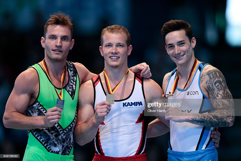 <a gi-track='captionPersonalityLinkClicked' href=/galleries/search?phrase=Fabian+Hambuechen&family=editorial&specificpeople=213637 ng-click='$event.stopPropagation()'>Fabian Hambuechen</a> (C) with first place of Germany <a gi-track='captionPersonalityLinkClicked' href=/galleries/search?phrase=Andreas+Bretschneider&family=editorial&specificpeople=8780987 ng-click='$event.stopPropagation()'>Andreas Bretschneider</a> (L) and <a gi-track='captionPersonalityLinkClicked' href=/galleries/search?phrase=Marcel+Nguyen&family=editorial&specificpeople=241408 ng-click='$event.stopPropagation()'>Marcel Nguyen</a> (R) pose with their medals after winning the German Gymnastics Championship Day 2 at Sporthalle Hamburg on June 26, 2016 in Hamburg, Germany.