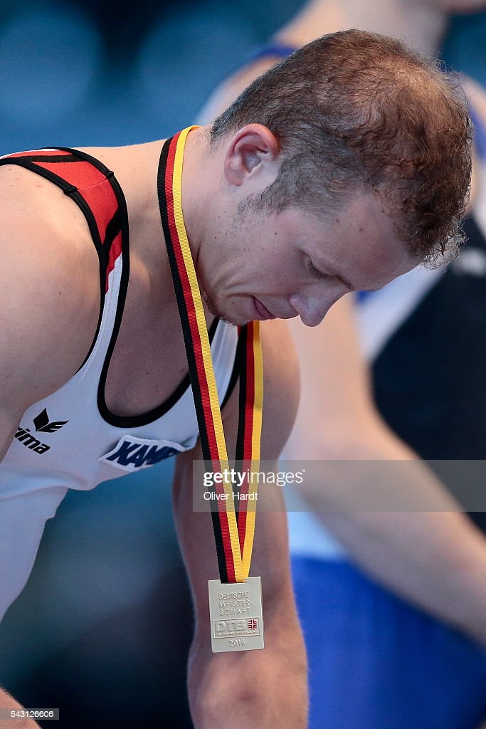 <a gi-track='captionPersonalityLinkClicked' href=/galleries/search?phrase=Fabian+Hambuechen&family=editorial&specificpeople=213637 ng-click='$event.stopPropagation()'>Fabian Hambuechen</a> with first place of Germany pose with their medal after winning the German Gymnastics Championship Day 2 at Sporthalle Hamburg on June 26, 2016 in Hamburg, Germany.
