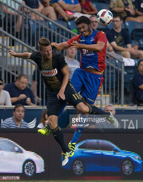 Fabian Herbers of Philadelphia Union goes up for a header along with James Tomkins of Crystal Palace FC during the international friendly at Talen...