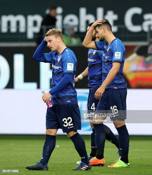 Fabian Holland Aytac Sulu and Antonio Colak of Darmstadt leave the pitch after the Bundesliga match between VfL Wolfsburg and SV Darmstadt 98 at...