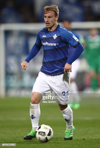 Fabian Holland of Darmstadt controles the ball during the Bundesliga match between SV Darmstadt 98 and Bayer 04 Leverkusen at Jonathan Heimes Stadion...