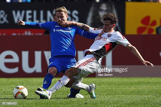 Fabian Holland of Darmstadt is challenged by Pascal Gross of Ingolstadt during the Bundesliga match between SV Darmstadt 98 and FC Ingolstadt at...