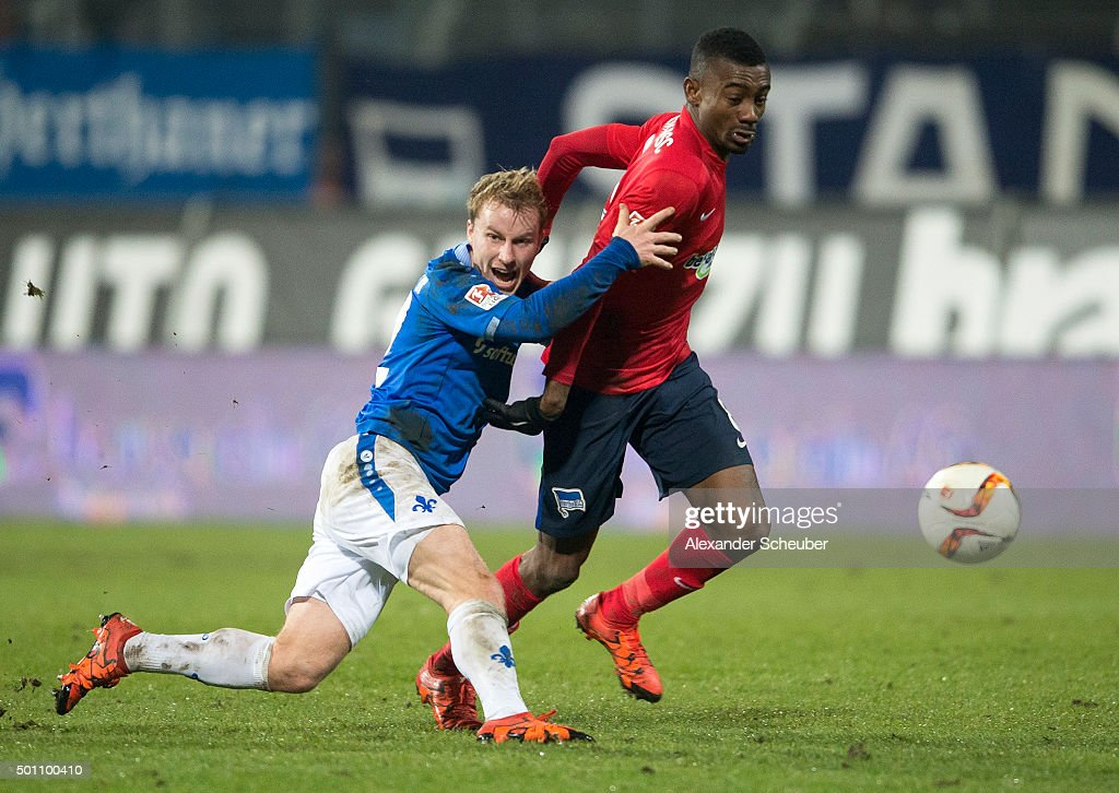 Fabian Holland of SV Darmstadt 98 challenges Salomon Kalou of Hertha BSC during the bundesliga match between SV Darmstadt 98 and Hertha BSC at Merck-Stadion am Boellenfalltor on December 12, 2015 in Darmstadt, Germany.