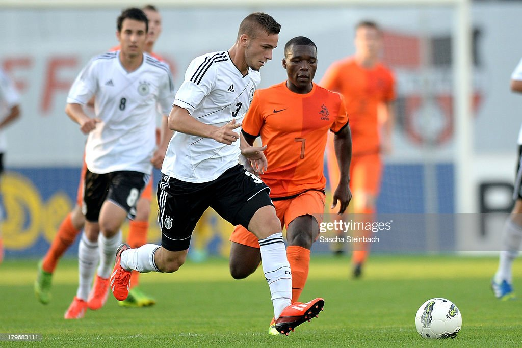 Fabian Holthaus (L) from Germany vies with Moussa Sanoh (R) from The Netherlands during the U19 international friendly match between The Netherlands and Germany on September 6, 2013 in Nijmegen, Netherlands.