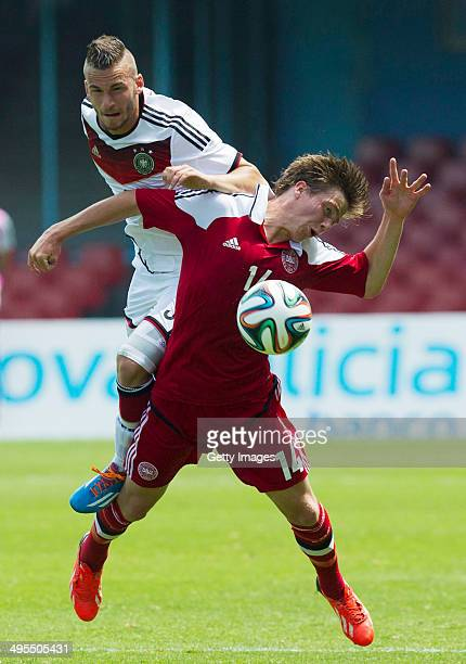 Fabian Holthaus of Germany challenges Frederik Borsting of Denmark during the UEFA Under19 Elite Round match between U19 Germany and U19 at Estadio...