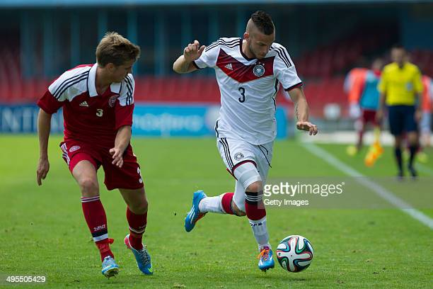 Fabian Holthaus of Germany challenges Jeppe Brinch of Denmark during the UEFA Under19 Elite Round match between U19 Germany and U19 at Estadio...