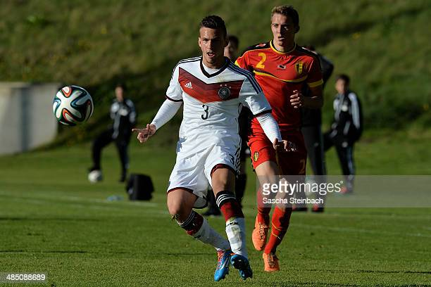 Fabian Holthaus of Germany vies with Timothy Castagne of Belgium during the U19 International Friendly match between Germany and Belgium at Stadion...