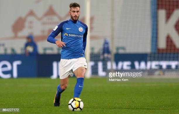 Fabian Holthaus of Rostock runs with the ball during the third league match between FC Hansa Rostock and VfL Osnabrueck at Ostseestadion on October...