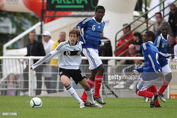 Fabian Hurzeler of Germany and Paul Pogba of France battle for the ball during the U16 international friendly match between France and Germany at the...