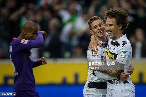 Fabian Johnson and goal scorer Thorgan Hazard of Moenchengladbach celebrate after scoring a goal to make it 10 the Bundesliga match between Borussia...