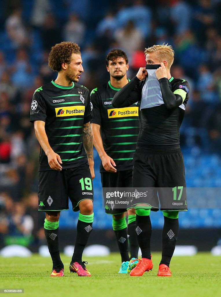 Fabian Johnson of and Oscar Wendt of Borussia Moenchengladbach show their dejection after the UEFA Champions League match between Manchester City FC and VfL Borussia Moenchengladbach at Etihad Stadium on September 14, 2016 in Manchester, England.