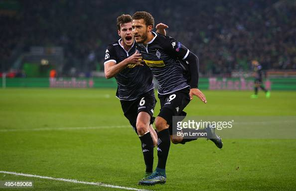 Fabian Johnson of Borussia Moenchengladbach celebrates with Havard Nordtveit as he scores their frist goal during the UEFA Champions League Group D...