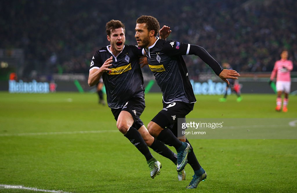 <a gi-track='captionPersonalityLinkClicked' href=/galleries/search?phrase=Fabian+Johnson&family=editorial&specificpeople=677415 ng-click='$event.stopPropagation()'>Fabian Johnson</a> of Borussia Moenchengladbach (19) celebrates with Havard Nordtveit as he scorer their frist goal during the UEFA Champions League Group D match between VfL Borussia Monchengladbach and Juventus at Borussia-Park on November 3, 2015 in Moenchengladbach, Germany.