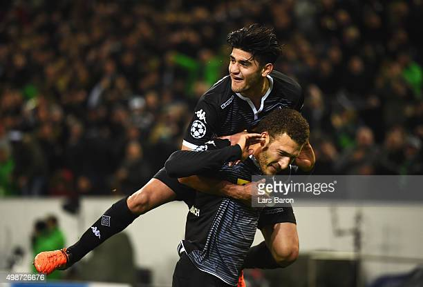 Fabian Johnson of Borussia Moenchengladbach celebrates with Mahmoud Dahoud as he scores their second goal during the UEFA Champions League Group D...