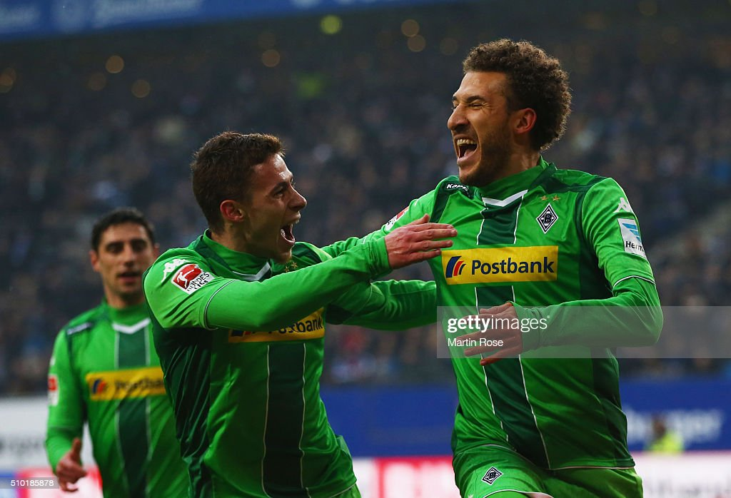 Fabian Johnson of Borussia Moenchengladbach (R) celebrates with Thorgan Hazard (C) as he scores their first goal during the Bundesliga match between Hamburger SV and Borussia Moenchengladbach at Volksparkstadion on February 14, 2016 in Hamburg, Germany.