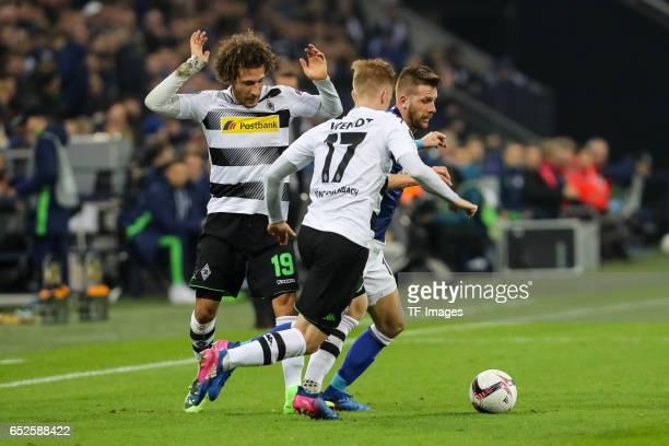 Fabian Johnson of Borussia Moenchengladbach Oscar Wendt of Borussia Moenchengladbach and Guido Burgstaller of Schalke battle for the ball during the...